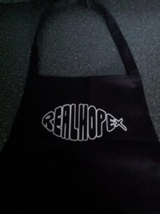 Look at our new logo on our new aprons.